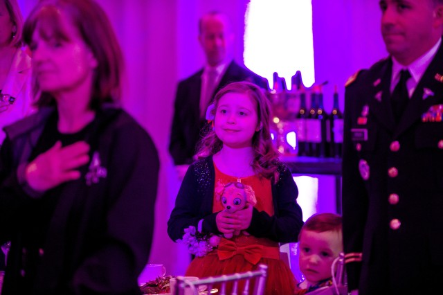 Lorelei McIntyre-Brewer, 10, stands during the playing of the National Anthem at the Military Child of the Year Awards Gala, in Arlington, Va., April 14, 2016. Mcintyre-Brewer was an award recipient during the annual event that celebrates military children who demonstrate leadership, resilience and strength of character, as well as an ability to thrive while dealing with the challenges inherent in military life.