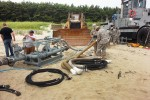 Soldiers from the 348th Quartermaster Company work with a Navy engineer to connect a hose line to a pump during the Combined Joint Logistics Over-the-Shore 2015 exercise in the Republic of Korea.