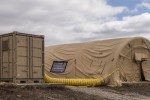 Natick's Minimized Logistics Habitat Unit, or MILHUT, is a containerized shelter that relies on renewable energy technologies, which enable warfighters to be deployed longer in remote areas without the need for resupply. The MILHUT system provides habitat, hygiene and meal preparation capabilities that are not usually available with deployments to remote, austere areas.