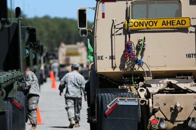 Nebraska Army National Guard Soldiers make final preparations at Military Operation Terminal Sunny Point, N.C., as they gear up for a 45-vehicle convoy for a trip to McAlester Army Ammunition Plant in Oklahoma. U.S. Army photos by Sgt. Eben Boothby.