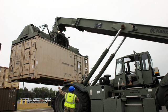 Members of the Military Surface Deployment and Distribution Command's (SDDC), 597th Transportation Brigade's, 832nd Transportation Battalion are participating in a Sea emergency Deployment Readiness Exercise (SEDRE) in Jacksonville, Fla. from April 4 to 23. Pictured are Soldiers from the 11th Transportation Battalion pre-positioning all of the equipment the 832nd moved from Fort Campbell, Ken. Via railroad, to be placed upon a ship destined for Beaumont, Texas. (U.S. Army photo by John Orrell)