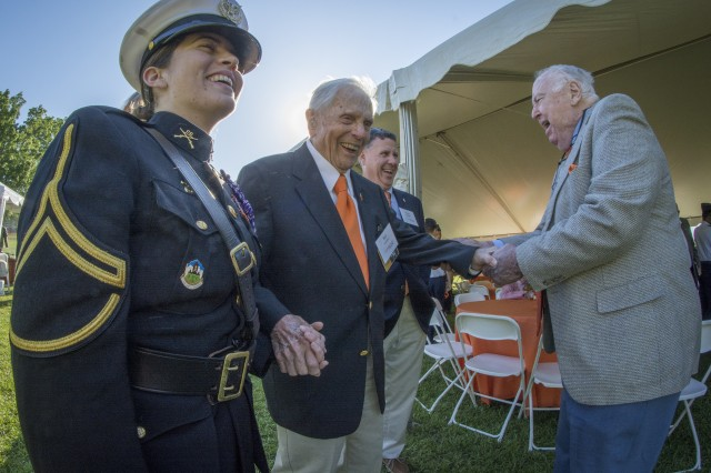 Retired U.S. Army Col. Ben Skardon (center) shares a laugh with Clemson Univeristy Reserve Officers' Training Corps cadet Liz Wilson and Clemson President emeritus Philip Prince (right) before the ROTC 100th anniversary celebration on Bowman Field, April 14, 2016. Skardon is a beloved alumnus and professor emeritus of Clemson as well as the only survivor of the Bataan Death March that walks in the memorial march. (U.S. Army photo by Staff Sgt. Ken Scar)