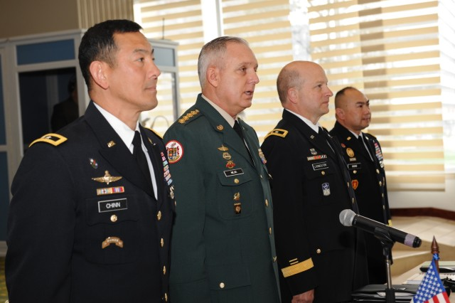 Bogota, COLOMBIA— (Left to right) Maj. Gen. K.K. Chinn, U.S. Army South commander, Gen. Alberto Jose Mejia, Colombian army commander, Maj. Gen. Robert Livingston, The Adjutant General of South Carolina, and Brig. Gen. James P. Wong, Army South deputy commanding general, stand for the playing of the Colombian national anthem at the start of the 2016 U.S.-Colombia Bilateral Army Staff Talks Executive Meeting in Bogota, Colombia April 12.