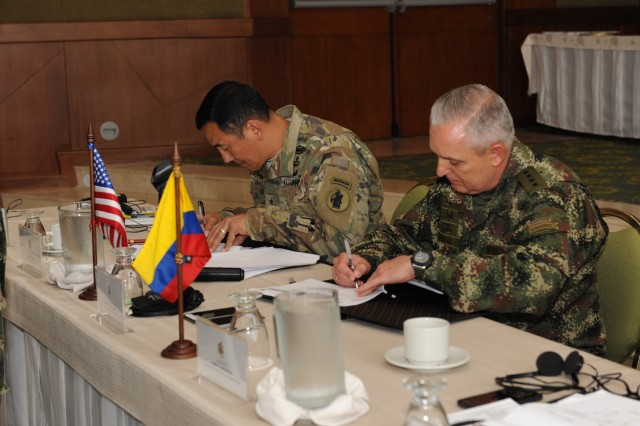 Bogota, COLOMBIA— Maj. Gen. K.K. Chinn (left), U.S. Army South commander, and Gen. Alberto Jose Mejia, Colombian army commander, sign the agreed-to-actions between the two armies during the closing ceremony of the 2016 U.S.-Colombia Bilateral Army Staff Talks Executive Meeting in Bogota, Colombia April 14.