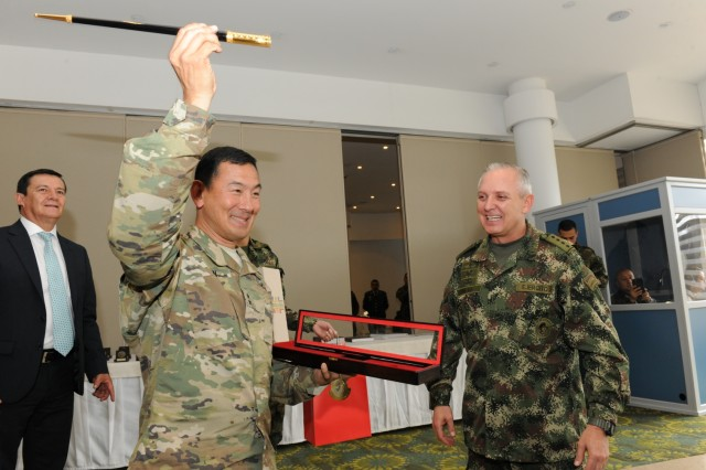 Bogota, COLOMBIA— Maj. Gen. K.K. Chinn (left), U.S. Army South commander, holds up a swagger stick that was presented to him by Gen. Alberto Jose Mejia, Colombian army commander, during the closing ceremony of the 2016 U.S.-Colombia Bilateral Army Staff Talks Executive Meeting in Bogota, Colombia April 14.