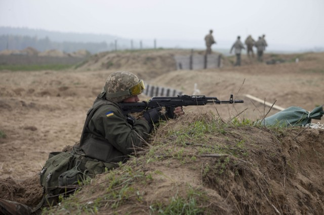 Ukrainian soldier fires his weapon during a live-fire exercie