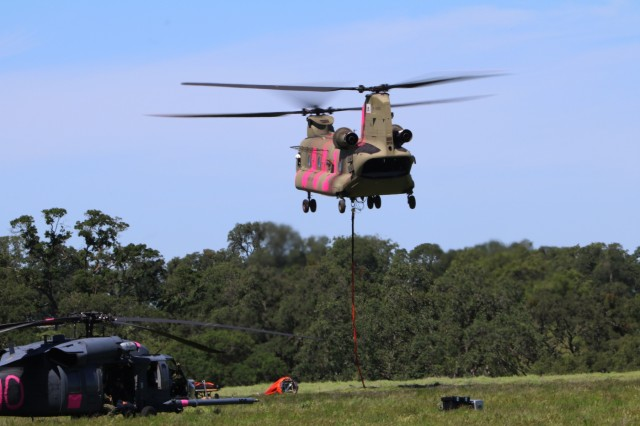 A CH-47 Chinook helicopter from 1st Battalion, 126th Aviation Regiment hoists a 2,000 gallon bucket during training near Sutter Creek, California, April 16. The annual Wild Land Fire Fighting training prepares the California National Guard and CAL FIRE to work together during the upcoming wildfire season.