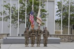 The color guard stands at attention in the Summit Garden at Bagram Airfield, Afghanistan, for the U.S. Army Expeditionary Contracting Command-Afghanistan transfer of authority ceremony April 10.