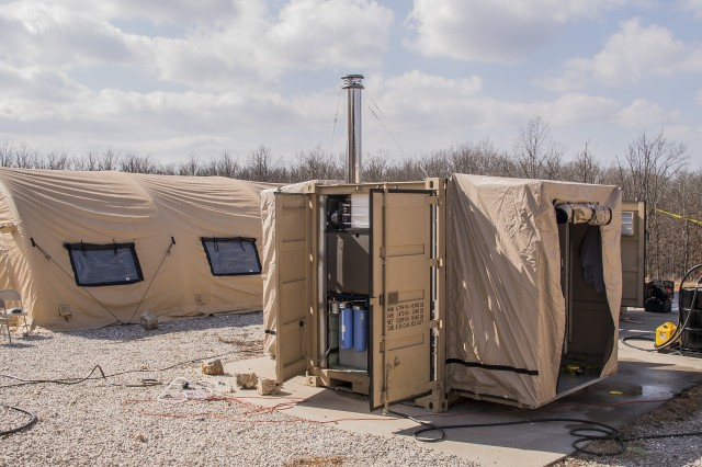 Natick's Minimized Logistics Habitat Unit is well-suited for austere environments because it is easily transported and can be set up quickly. It is primarily self-sufficient and relies on renewable energy technologies, such as solar power and water recycling.