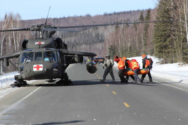 U.S. Army Alaska Aviation Task Force, in conjunction with Alaska State Troopers and Wilderness Search and Rescue, conduct medical evacuation training Mar. 25, 2015 at Linengood, Alaska. The event tested the agencies' cooperation and reaction time in response to emergency situations in the Alaska interior.