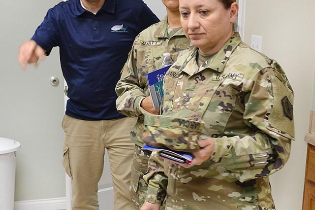 Silverleaf therapist Jason Gati (from left), Sgt. 1st Class Shannon Wyatt, HRC SHARP program manager, and her predecessor, Master Sgt. Johnnie Garcia, tour the sexual trauma intervention center's medical examination facilities in Elizabethtown, Kentucky, March 31.