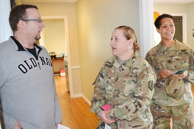 Silverleaf victim advocate Terry Jackson (from left), Master Sgt. Johnnie Garcia and HRC SHARP program manager, Sgt. 1st Class Shannon Wyatt, discuss coordination of efforts at the sexual trauma intervention center in Elizabethtown, Kentucky, March 31.