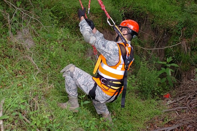 A Soldier with the Texas Natonal Guard's 836th Sapper Co., 6th CBRNE Enhanced Response Force Package -- CERFP, part of the Joint Task Force 136th (Maneuver Enhancement Brigade), prepares to rappel down a steep embankment during a low-angle rescue mission, as part of exercise Operation Vigilant Guard 2016 near Baton Rouge, La. April 15-17, 2016. Vigilant Guard focused on testing many of the state's response plans by having a Category 3 or 4 hurricane make landfall somewhere along the coast of Louisiana. In addition to fostering relationships between military and civilian partner agencies, the exercise allowed the exchange of ideas and best practices between the Louisiana and Texas CERFP units. (U.S. Army National Guard photo by Staff Sgt. Jennifer D. Atkinson/Released)