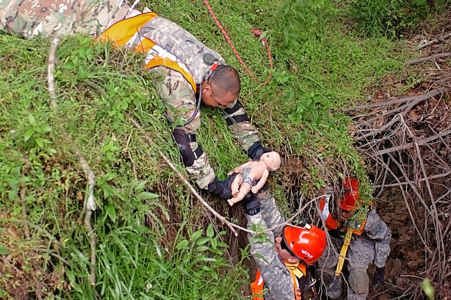 "Soldiers with theTexas Natonal Guard's 836th Sapper Co., 6th CBRNE Enhanced Response Force Package -- CERFP, part of the Joint Task Force 136th (Maneuver Enhancement Brigade), hand off an infant ""casualty"" during a low-angle rescue mission, as part of exercise Operation Vigilant Guard 2016 near Baton Rouge, La. April 15-17, 2016. Vigilant Guard focused on testing many of the state's response plans by having a Category 3 or 4 hurricane make landfall somewhere along the coast of Louisiana. In addition to fostering relationships between military and civilian partner agencies, the exercise allowed the exchange of ideas and best practices between the Louisiana and Texas CERFP units. (U.S. Army National Guard photo by Staff Sgt. Jennifer D. Atkinson/Released)"