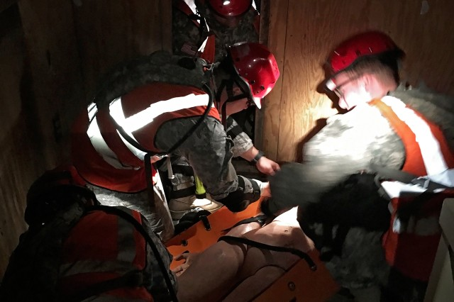Soldiers with the Texas Natonal Guard's 836th Sapper Co., 6th CBRNE Enhanced Response Force Package -- CERFP, part of the Joint Task Force 136th (Maneuver Enhancement Brigade), work to stabilize a casualty by flashlight in near pitch dark during a collapsed structure rescue mission, as part of exercise Operation Vigilant Guard 2016 near Baton Rouge, La. April 15-17, 2016. Vigilant Guard focused on testing many of the state's response plans by having a Category 3 or 4 hurricane make landfall somewhere along the coast of Louisiana. In addition to fostering relationships between military and civilian partner agencies, the exercise allowed the exchange of ideas and best practices between the Louisiana and Texas CERFP units. (U.S. Army National Guard photo by Staff Sgt. Jennifer D. Atkinson/Released)