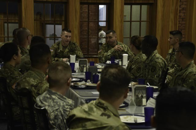 Soldiers from 1st Battalion, 1st Air Defense Artillery Regiment, 94th Army Air and Missile Defense Command have lunch with Sgt. Maj. of the Army Daniel A. Dailey on April 5, 2016 at Marshal Dining Facility on Kadena Air Base, Okinawa, Japan. The visit by Dailey consisted of an open forum discussion with Soldiers followed by a demonstration of Patriot missile reload operations by Patriot crews of Battery D, 1-1 ADA.