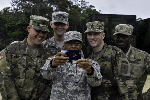 "Soldiers from Battery C, 1st Battalion, 1st Air Defense Artillery Regiment, 94th Army Air and Missile Defense Command take a ""selfie"" with Sgt. Maj. of the Army Daniel A. Dailey during his visit on April 5, 2016 to Kadena Air Base, Okinawa, Japan. The visit by Dailey consisted of an open forum discussion with Soldiers followed by a demonstration of Patriot missile reload operations by Patriot crews of Battery D, 1-1 ADA."