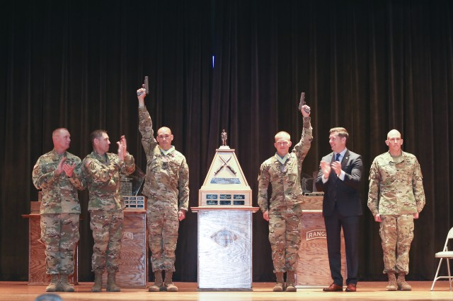 Staff Sgt. Erich Friedlein and Capt. Robert Killian, representing the National Guard are the 2016 David E. Grange Best Ranger Competition winners. Acting Secretary of the Army Patrick Murphy presented awards to the winning team, April 18, 2016. In July 1981, the Ranger department was asked to design and conduct a Ranger Olympics to identify the best two-man buddy team and the annual event is held annually at Fort Benning, Ga.