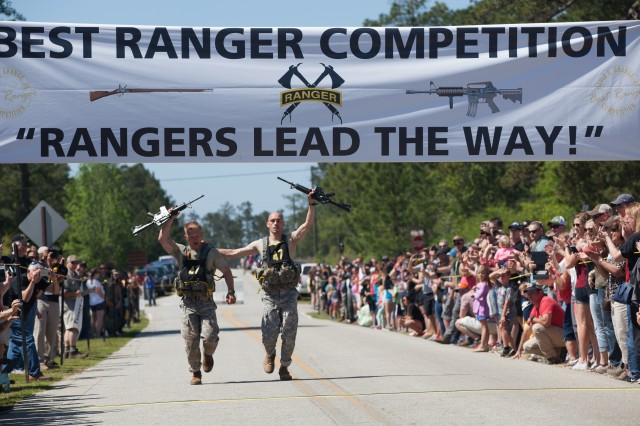 U.S. Army Capt. Robert Killian and Staff Sgt. Erich Friedlein, assigned to the National Guard, run toward the finish line at Camp Rogers, Fort Benning, Ga., April 17, 2016. The 33rd annual Best Ranger Competition 2016 is a three-day event consisting of challenges to test competitor's physical, mental, and technical capabilities in honor of Lt. Gen. David E. Grange Jr.