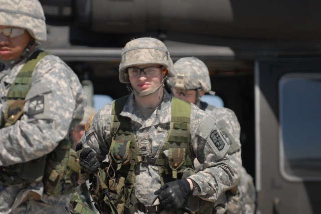 Army cadets from Niagara University and Canisius College unload from a UH-60M Black Hawk helicopter with 2nd Battalion, 10th Aviation Regiment, 10th Combat Aviation Brigade after arriving to Wheeler-Sack Army Airfield for their annual Joint Leadership Training Exercise (JLFX), April 14, 2016.  The JLFX is designed to give cadets an opportunity to refine and further develop their critical thinking and decisive leadership skills as they navigate through a series of common Soldier tasks and drills for four days.