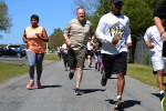 Approximately 50 Soldiers and civilians from five different units participate in the 80th Training Command Sexual Harassment Assault and Response Prevention 5k run and walk event at the Defense Logistics Agency Compound in Richmond, Va., April 20, 2016. The unit conducted the event in observance of Sexual Assault Awareness Month.