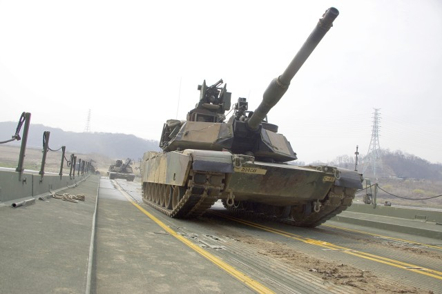 Soldiers in a 68-ton M1A2 Abrams Main Battle Tank cross the Imjin River, April 6, over a floating bridge assembled by the Soldiers of the 74th Multi-Role Bridge Company 'RiverRats,' 62nd Engineer Battalion, 36th Engineer Brigade. U.S. and South Korean forces worked together to conduct the large-scale, four-day combined arms river crossing exercise, one of the largest of its kind in more than a decade.