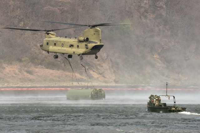 Soldiers of the 6th Squadron, 6th Cavalry Regiment 'Six-Shooters,' 10th Combat Aviation Brigade, in a CH-47 Chinook, airlift a segment of a floating bridge to the Imjin River, April 6, as Soldiers from the 74th Multi-Role Bridge Company 'RiverRats' 62nd Engineer Battalion, 36th Engineer Brigade move into place to capture the segment and move it into place to create a floating bridge. U.S. and South Korean forces conducted a four-day, combined arms river crossing exercise from April 5-8, one of the largest of its kind in more than a decade.