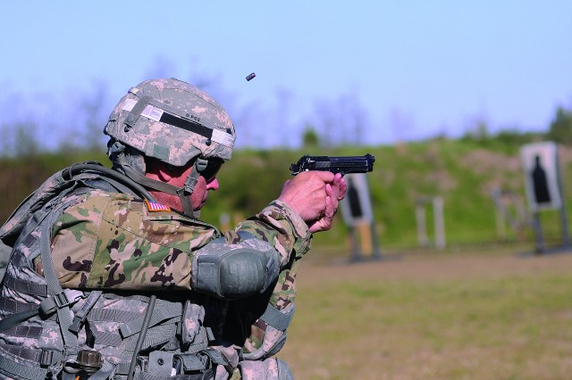 Staff Sgt. Jose Pacheco of the Soldier Support Institute at Fort Jackson, S.C., fires his 9mm pistol during qualifications for the Ultimate Warrior Competition April 20 at the installation range complex.