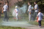 Children douse each other with colored powder during the Cody Child Development Center's Family Fitness Fun Day April 15. Dozens of Cody CDC families enjoyed a day of physical activity, including a quarter-mile color run during the event.