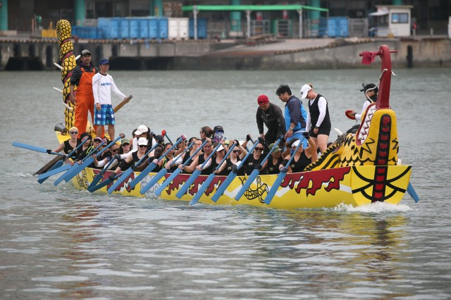Each spring on Okinawa, dragons come to life as thousands of onlookers descend on Tomari Wharf in Naha City to watch dozens of teams thrash through the sea, gliding on 50-foot-long dragon boats in a quest to claim the champion's cup.