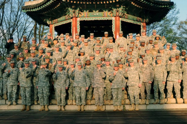 "Eighth Army Soldiers pose for photo at the top of Namsan Tower Apr. 19 following a foot march during a multi-day event called a ""commander's on-site."" During the event, Senior Leaders and their spouses conduct various informational meetings and breakout sessions to better serve their units."