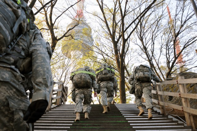 "Eighth Army Soldiers conduct a foot march at Namsan, Seoul, South Korea Apr. 19 during a multi-day event called a ""commander's onsite."" During the event, senior leaders conduct various informational meetings and breakout sessions to better serve their units."