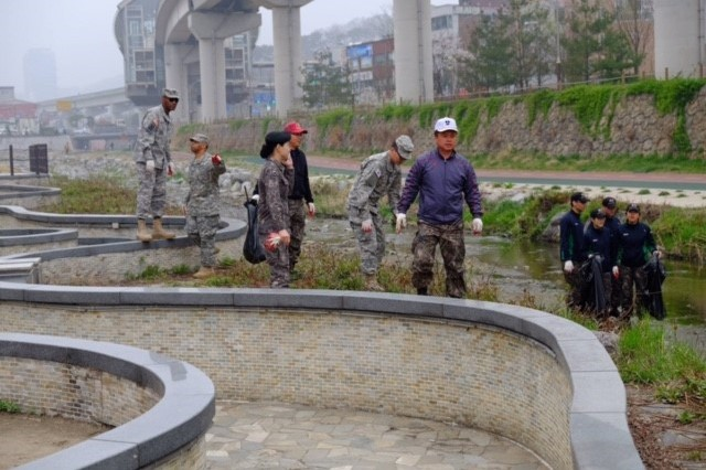 2501st Detachment Liaison Detachment Soldiers and Yongin University ROTC Cadets conduct clean-up along the Yongin River on Saturday, Apr. 9 during an area beautification project.