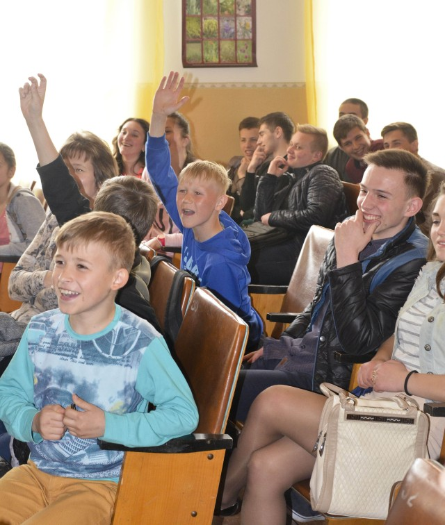 Ukrainian school children answer questions during a health class