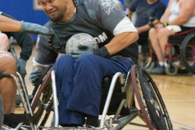 "Retired Army Sgt. 1st Class Sualauvi ""Sua"" Tuimalealifano, a member of U.S. Special Operations Command's (USSOCOM) Military Adaptive Sports Program (MASP), participates in a wheelchair rugby exhibition game. Sua is scheduled to compete in the 2016 Invictus Games and is one of 16 SOCOM athletes who will join the U.S. team, which includes the Army, Navy, Air Force and Marines, as they compete in adaptive sport competitions against athletes from 14 countries from May 8-12 in Orlando."