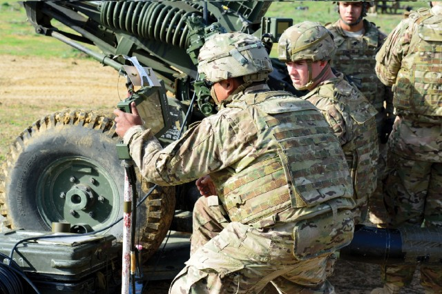 Soldiers from 4th Battalion, 319th Airborne Field Artillery Regiment (FAR), 173rd Airborne Brigade prepare an M119A3 howitzer for firing during the Exercise Shardana at Capo Teulada, Italy, conducted in October 2015. PM TAS continuously evaluates field artillery sustainment strategies to find the right balance to achieve operational availability. (U.S. Army photo by Visual Information Specialist Graigg Faggionato)
