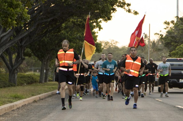 Brig. Gen. Eric L. Sanchez, commander, 94th Army Air and Missile Defense Command, leads Soldiers, Civilians and Family members of the 94th AAMDC on an esprit de corps run, April 1, on Joint Base Pearl Harbor Hickam, to highlight National Sexual Assault Awareness and Prevention Month (SAAPM). During SAAPM, the U.S. Army reaffirms its commitment to eliminate sexual assault within the Army, support victims, and inspire bystander intervention. The Army's 2016 SAAPM theme is Sexual Assault. Sexual Harassment. Not in Our Army.