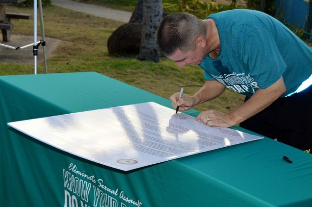 Brig. Gen. Eric L. Sanchez, commander, 94th Army Air and Missile Defense Command, signs a proclamation declaring April 2016 as sexual assault awareness and prevention month (SAAPM), April 1, at the Hickam Beach on Joint Base Pearl Harbor Hickam, Hawaii. During SAAPM, the U.S. Army reaffirms its commitment to eliminate sexual assault within the Army, support victims, and inspire bystander intervention. The Army's 2016 SAAPM theme is Sexual Assault. Sexual Harassment. Not in Our Army.