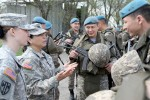 1st Lt. Danielle Steward,  mobility and maneuver support sfficer,  and Capt. Tori Rodriguez, chief of protection, with 158th Maneuver Enhancement Brigade talk with Kazakhstani soldiers during Steppe Eagle 16, Apr 11.  Steppe Eagle is one of many opportunities members of the Arizona National Guard use to grow their relationship with Kazakhstan as part of the State Partnership Program. (U.S. Army photo by Maj. Chris Brautigam, USARCENT Public Affairs)