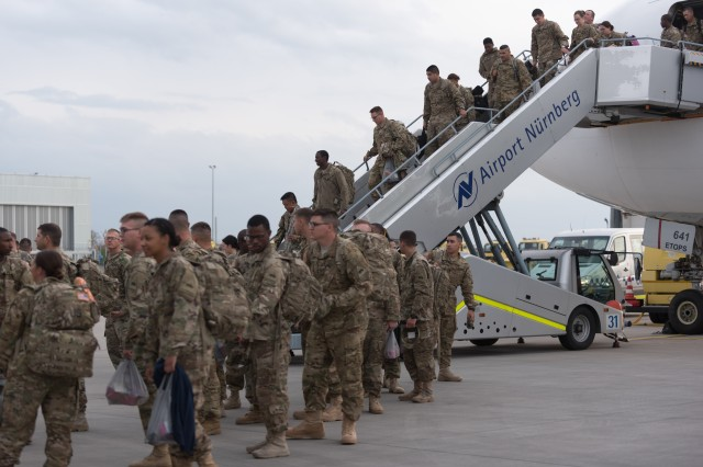"Soldiers of the 1st Armored Division Combat Aviation Brigade, ""Iron Eagles"", from Fort Bliss, Texas, arrive at Albrecht Dürer Airport, Nuernburg, Germany, April 26, 2016. The Soldiers from 1AD CAB are in USAREUR as an augmentation or surge force to further enable the 12th Combat Aviation Brigade during Anakonda 16. (U.S. Army photo by Spc. Antonio Ramirez, 12th CAB/released)"