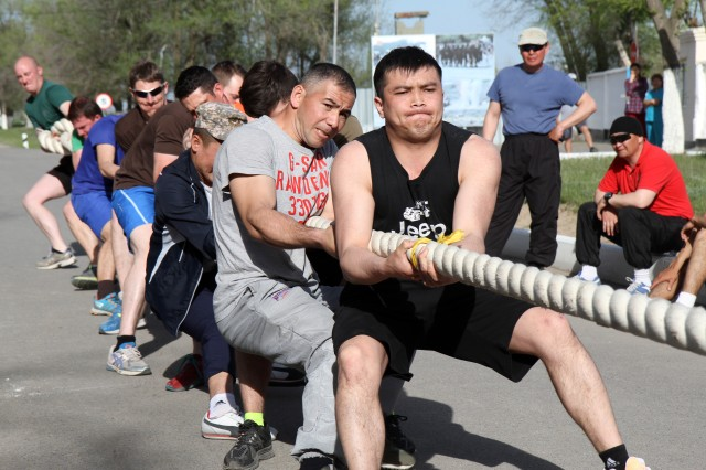 A team of soldiers from the Kazakhstan, the United Kingdom and the United States compete against another multinational team in a tug-of-war competition during Steppe Eagle 16.  Steppe Eagle is a multinational exercise with participation from Servicemembers from Kazakhstan, U.K. and the U.S.  (U.S. Army photo by Maj. Chris Brautigam, USARCENT Public Affairs)