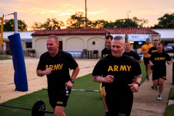 Command Sgt. Maj. Timothy L. Metheny, left, does Physical Training with Command Sgt. Maj. John Wayne Troxell, senior enlisted advisor to the Chairman of of the Joint Chiefs of Staff during his visit Friday April 23, 2016.