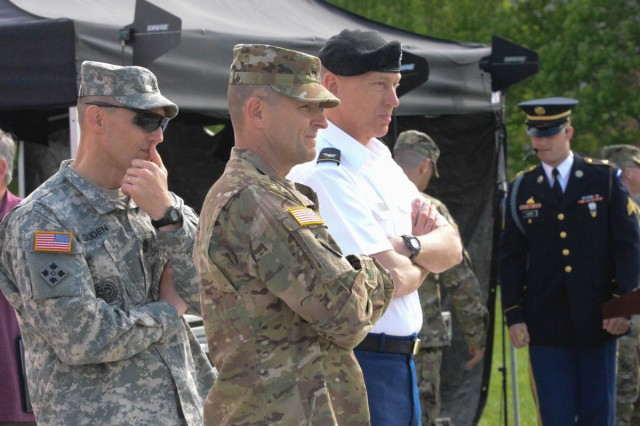 "Maj. Gen. Bradley A. Becker, commanding general, U.S. Army Military District of Washington (center), observes the Twilight Tattoo full dress rehearsal April 26, 2016 on Joint Base Myer-Henderson Hall along with Col. Timothy Holden, leader and commander, U.S. Army Band ""Pershing's Own,"" and Command Sgt. Maj. Timothy Guden, MDW command sergeant major."