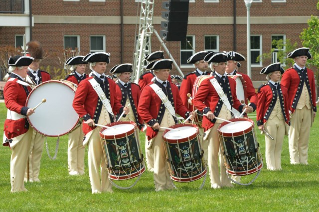 Soldiers from the 3rd U.S. Infantry Regiment (The Old Guard) Fife and Drum Corps, perform during a full dress rehearsal on Summerall Field, Joint Base Myer-Henderson Hall, April 26, 2016, in preparation for the U.S. Army Military District of Washington's 2016 Twilight Tattoo season.
