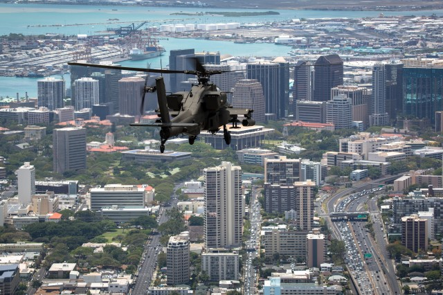 An AH-64D Apache from 2-6 Cavalry Squadron, 25th Combat Aviation brigade, flies through downtown Honolulu en route to Wheeler Army Airfield, April 24. The Apaches were reassigned to the 25th Combat Aviation Brigade from National Guard units as part of U.S. Army Aviation restructuring.