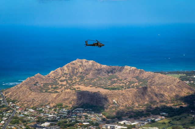 An AH-64D Apache from 2-6 Cavalry Squadron, 25th Combat Aviation brigade flies over the Diamond Head State Monument en route to Wheeler Army Airfield, April 24. The Apaches were reassigned to the 25th Combat Aviation Brigade from National Guard units as part of U.S. Army Aviation restructuring.