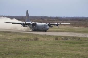 "A C-130 ""Hercules"" aircraft, operated by aviators from the 103rd Airlift Wing, Connecticut Air National Guard, touches down on the Belvedere Flight Landing Strip during a training exercise April 25. The aircraft became the first to land on the runway in about a decade."