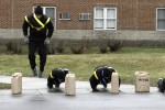 A group of Soldiers complete burpees before executing a penalty water can carry during the 2nd Brigade Combat Team's Sexual Assault Awareness Challenge held April 11 on Fort Drum.