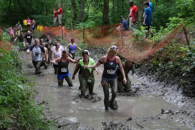 Participants navigate a mud pit during the 2015 race.