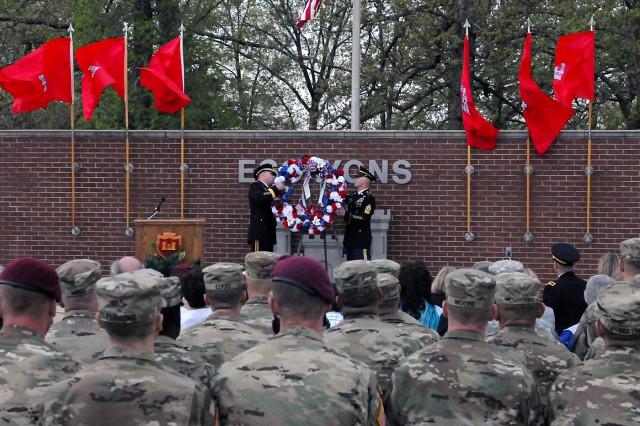 Brig. Gen James Raymer, U.S. Army Engineer School commandant, left, and Command Sgt. Maj. Bradley Houston, regimental command sergeant major, place a wreath during the Fallen Sapper Memorial at Sapper Grove.